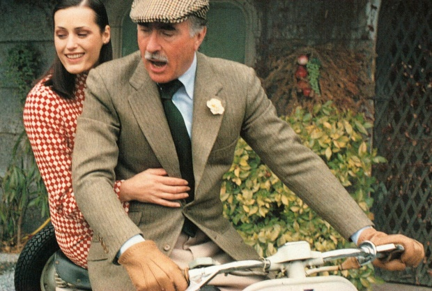 Luciano-Barbera-on-a-bike-with-boutonniere