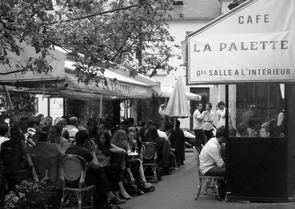 La Palette has a wonderful interior. However it is more famous for It's extensive covered terrace frequented by Fine Arts students, nearby gallery owners and artists. See more here - http://www.cafelapaletteparis.com/