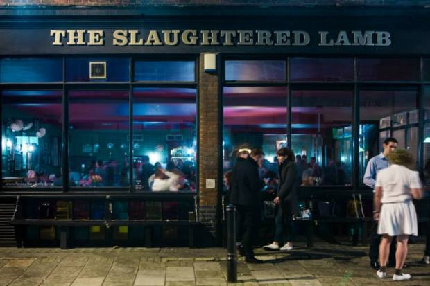 The Slaughtered Lamb is a Public House in Clerkenwell, London. It's one of very few pubs in London, that whilst being very British also embody many of the exciting characteristics of Parisian nightlife.  TSL is located in the dense city centre, on the corner of a block where 2 backstreets meet. Large open windows and ample exterior seating space prompt customers spill out onto the street conversing and consuming.  Inside there's space to sit or stand, loud music and a cool clientele of young creative professionals add to it's charm and atmosphere.  If it wasn't already Parisian enough, red neon lighting and the blunt bar staff give it that cerise sur le gâteaux! See more here - http://www.theslaughteredlambpub.com/