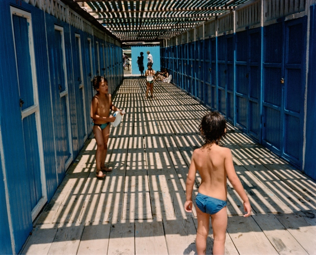 Dolce Via: Italy in the 1980s is a book featuring photographs by Charles H. Traub, with a foreword by Max Kozloff and a dialogue by Luigi Ballerini. Colour photographs by Traub from his visits to Italy during the 1980's. See more here -  http://www.charlestraub.com/