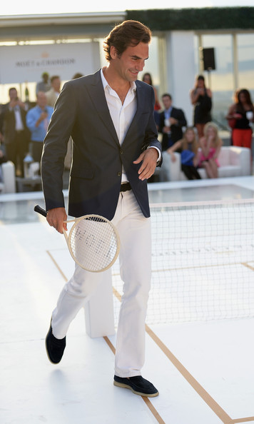 "Roger Federer attends the Moet & Chandon ""Tiny Tennis"" party at Club 50 at Viceroy Miami, Florida. Photo by Gustavo Caballero/Getty Images for Moet & Chandon."